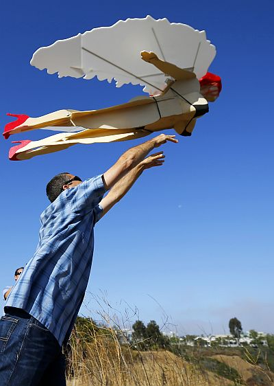 Ed Hanley launches its radio-controlled plane Ms. Emerson.