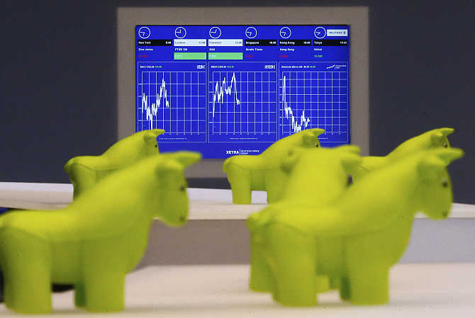 Styrofoam bull figurines are pictured in front of a monitor on the trading floor of Frankfurt's stock exchange in Germany. Photo is for representation purpose only.
