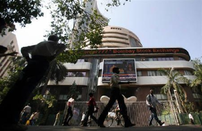 People walk past the Bombay Stock Exchange (BSE) building in Mumbai.