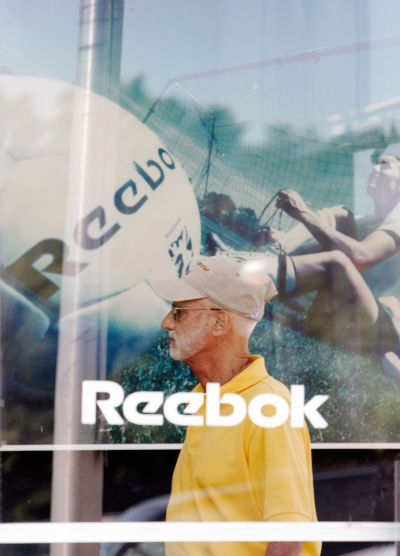 A customer enters the Reebok outlet store in Stoughton, Massachusetts.