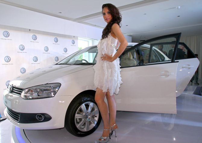 A model poses with the new Volkswagen's Vento during its launch in New Delhi.