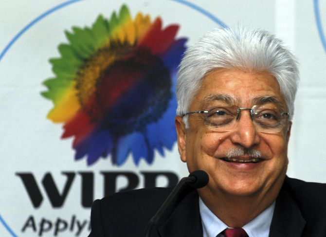 Azim Premji, chairman of Wipro Ltd., smiles during a news conference in the southern Indian city of Bangalore.