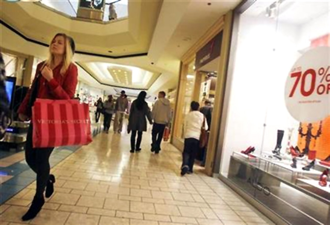 A woman walks at the Beverly Center shopping mall in Los Angeles.