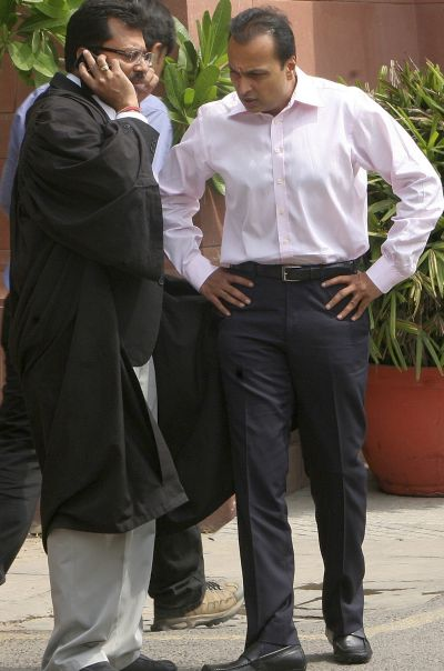 Anil Ambani (R), Chairman of Reliance Communications, talks to a lawyer outside Supreme Court.