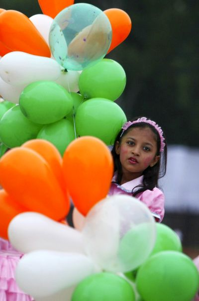 School children perform during the celebrations to mark India's Independence Day in C