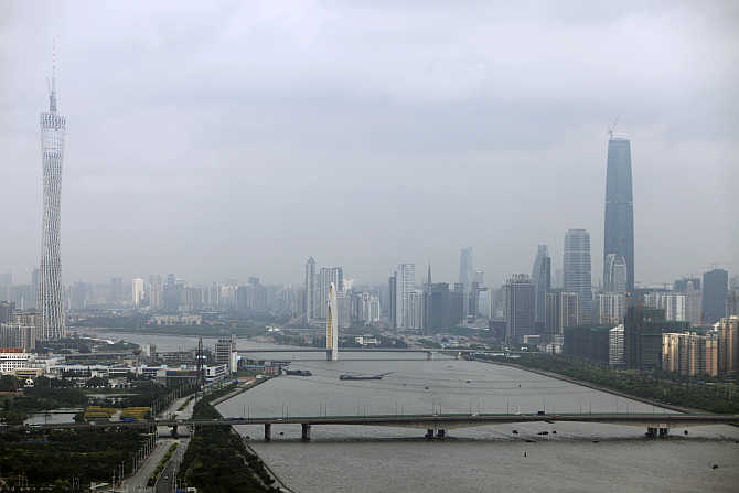 The 610-metre high Guangzhou TV & Sightseeing Tower, left, in Guangzhou.