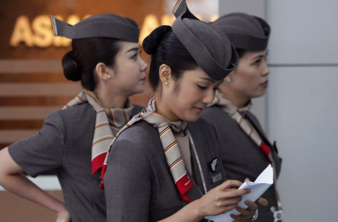 Asiana Airlines crew prepare to board their flight at the Incheon International Airport.
