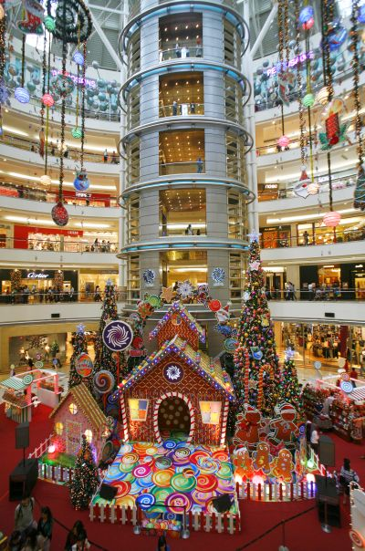 the lobby of a shopping mall is decorated with christmas decorations in kuala lumpur