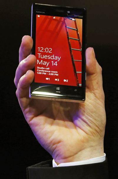 Nokia vice president for industrial design Stefan Pannenbecker holds the Nokia Lumia 925 at its launch.