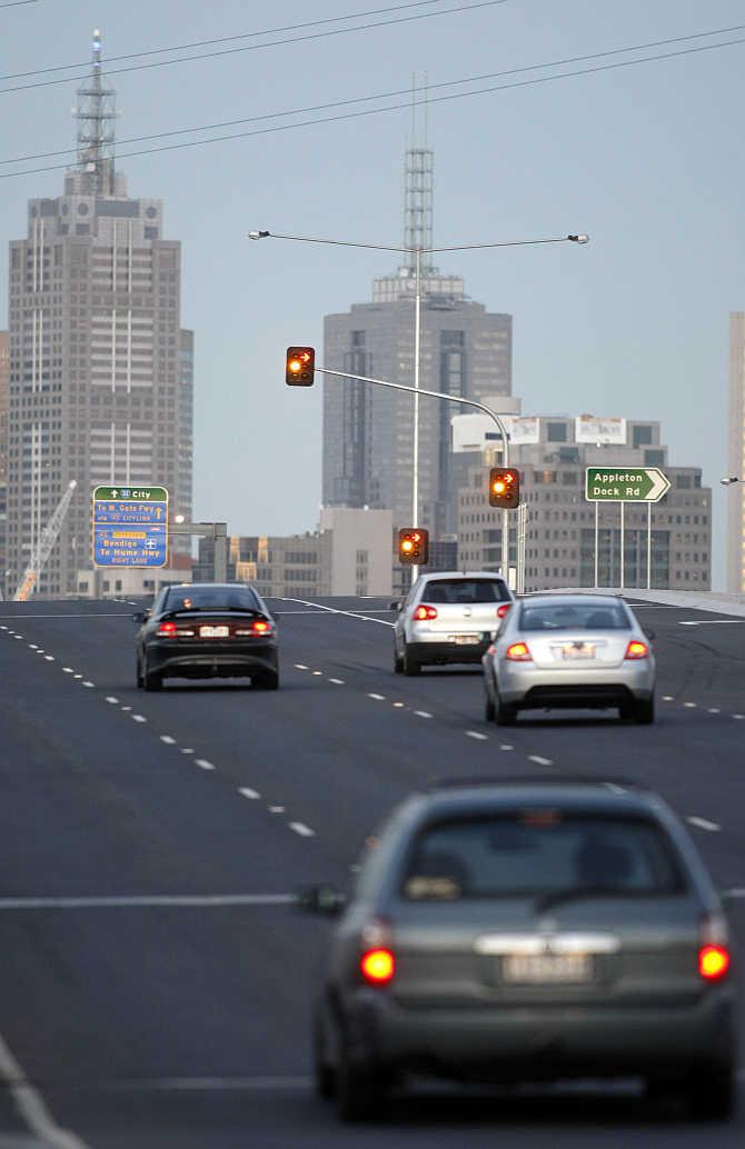 Cars drive over a bridge towards central Melbourne in Australia.