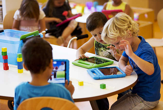 Students play with iPads at the Steve Jobs school in Sneek, the Netherlands.