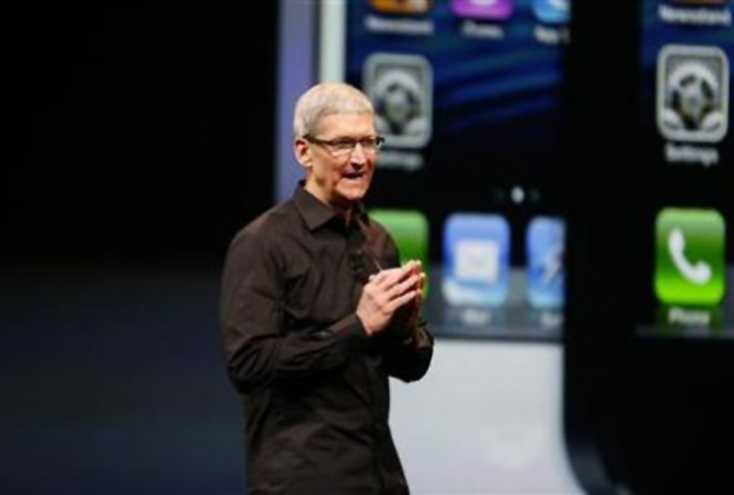 Apple Inc. CEO Tim Cook takes the stage after the introduction of the iPhone 5 during Apple Inc.'s iPhone media event in San Francisco.