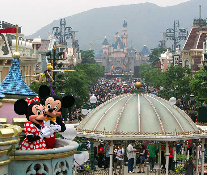 Mickey Mouse and Minnie Mouse perform at Hong Kong Disneyland.