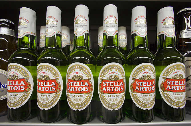 Bottles of Stella Artois beer are displayed at a store in Hong Kong's Sheung Wan district.
