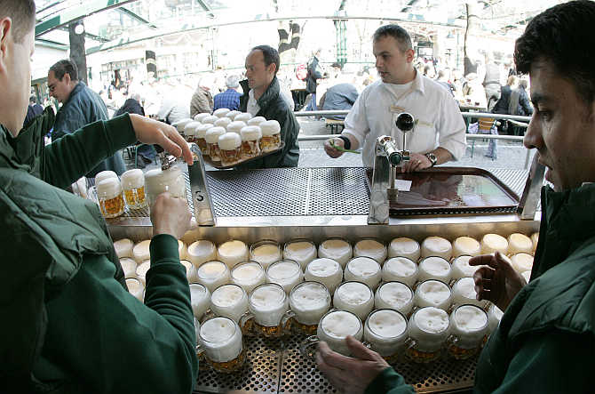 Beer is tapped at the opening of Vienna's Schweizerhaus, a traditional beer garden, at Vienna's amusement park in Austria.