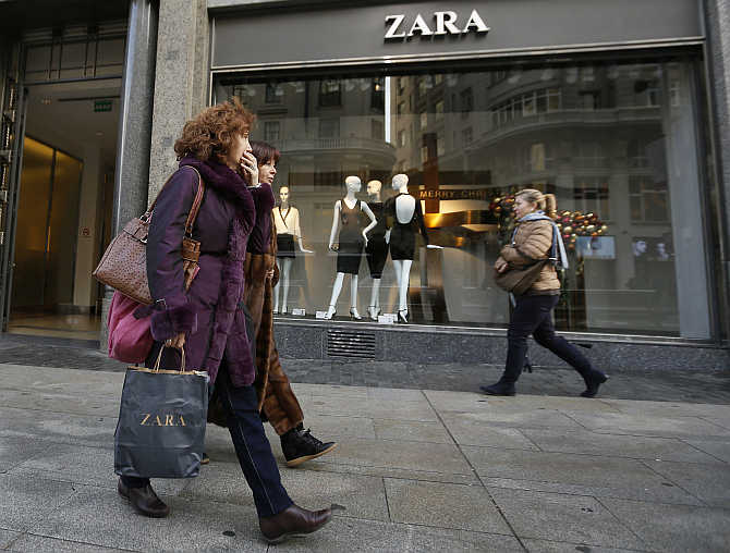 People walk past a Zara store in downtown Madrid, Spain.