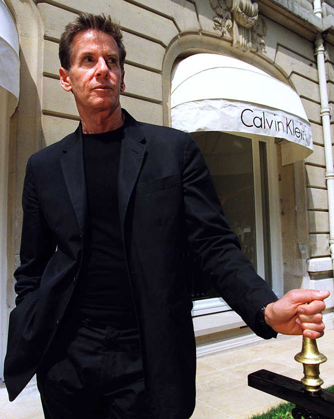 US designer Calvin Klein poses in front of his boutique on Avenue Montaigne in Paris, France.