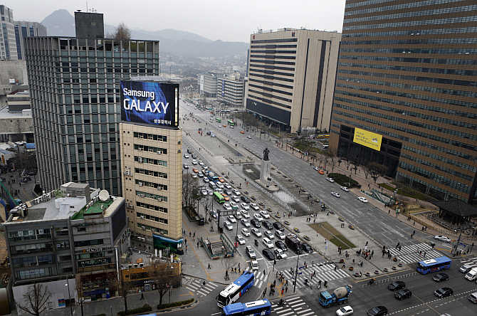 Samsung outdoor advertisement sits atop an office building in Seoul, South Korea.