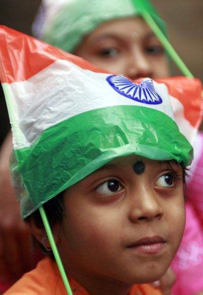 A child wears a cap made of national flag.