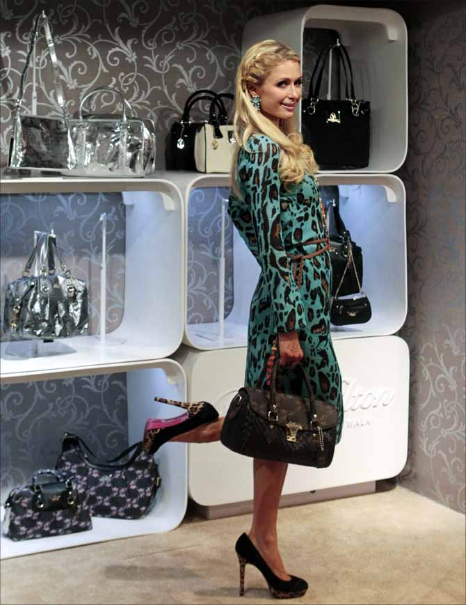 US socialite Paris Hilton poses for photographers inside a shopping mall in Mumbai.