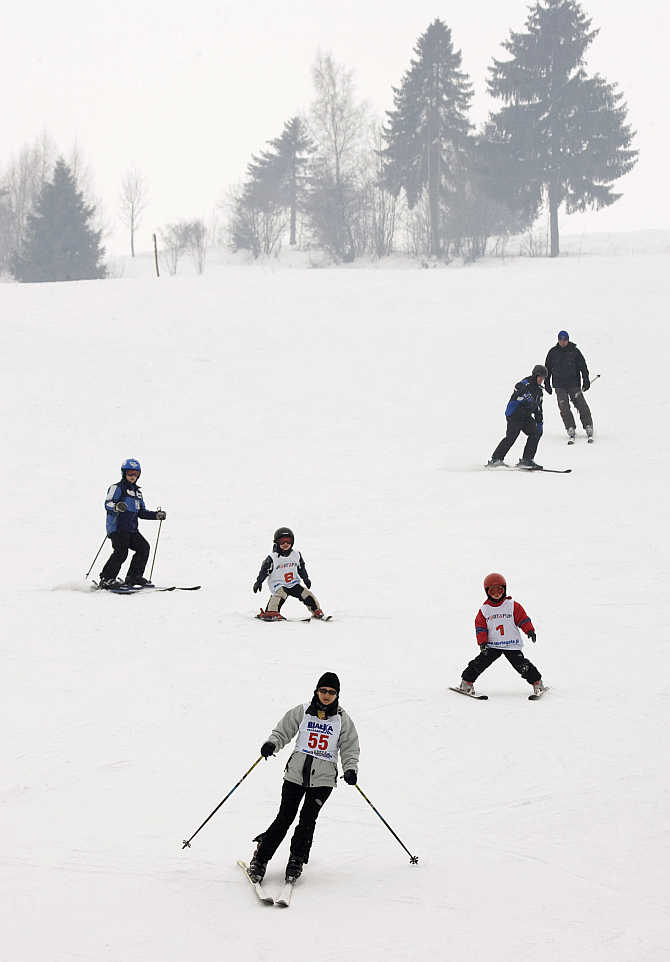 People enjoy skiing during the first spring day in the southern mountain town of Nowy Targ, some 400km south of Warsaw in Poland.