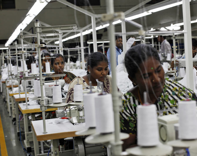 Employees at the Estee garment factory in Tirupur, Tamil Nadu. With knitwear exports of over $2 billion a year, India's garment manufacturing hub Tirupur has earned the nickname 'Dollar City,' but its allure for price-conscious global retailers obsessed by discounts of as little as one US cent pales before Bangladesh.