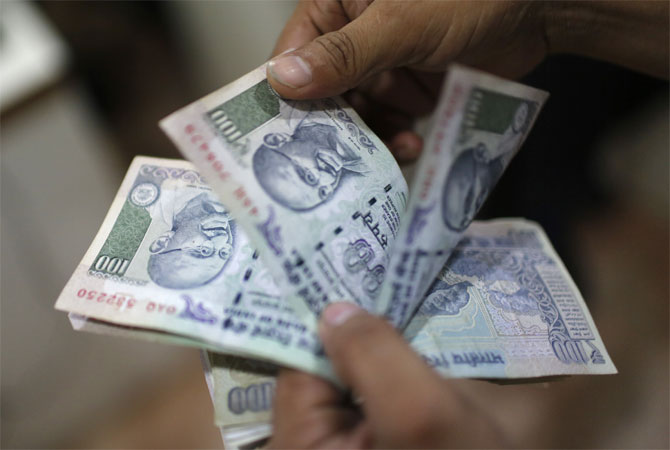 Rupee trims initial gains vs dollar, still up 17 paise