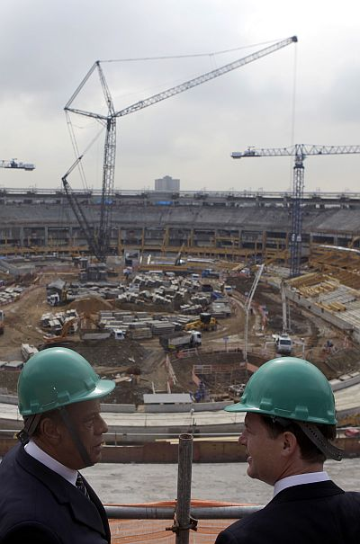 Britain's Deputy Prime Minister Nick Clegg (R) talks with Brazilian former soccer player Carlos Alberto Torres during a visit at the Maracana Stadium, undergoing renovations for the 2014 World Cup, in Rio de Janeiro.