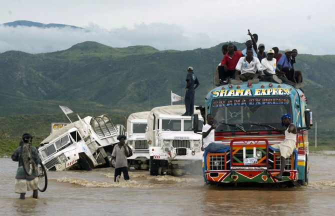 A UN truck overturns while a convoy makes its way to Gonaives after floodwaters covered Haiti's national highway.