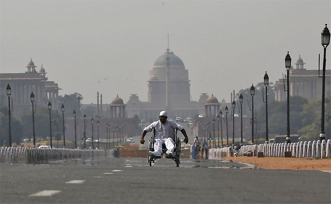 A man in a wheelchair makes his way to join protesters near Rashtrapati Bhavan.