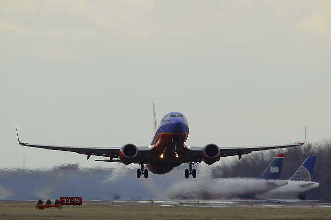 A Southwest Airlines passenger jet lifts off at Reagan National Airport in Washington.