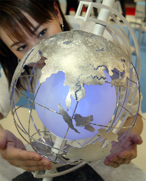 A globe made of 1600 grams of platinum is displayed at a jewelry exhibition in Tokyo.