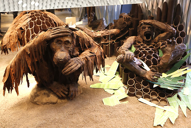 A monkey and a chimpanzee chocolate creations by French chocolate maker Patrick Roger are displayed in his shop in Paris.