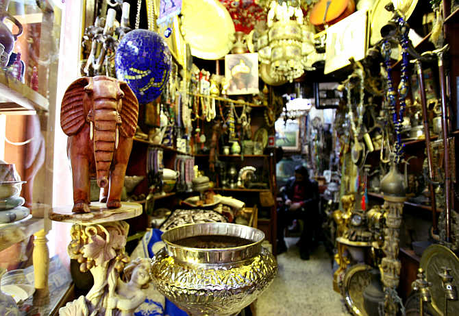 A shopkeeper works inside his shop in the old market of Tripoli, Libya.