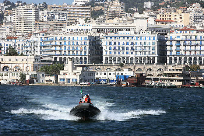 Coastguards cross the bay of the Mediterranean port of Algiers in Algeria.
