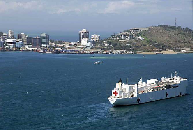 The United States's Military Sealift Command hospital ship USNS Mercy (T-AH 19) anchored off the coast of Papua New Guinea in Port Moresby.