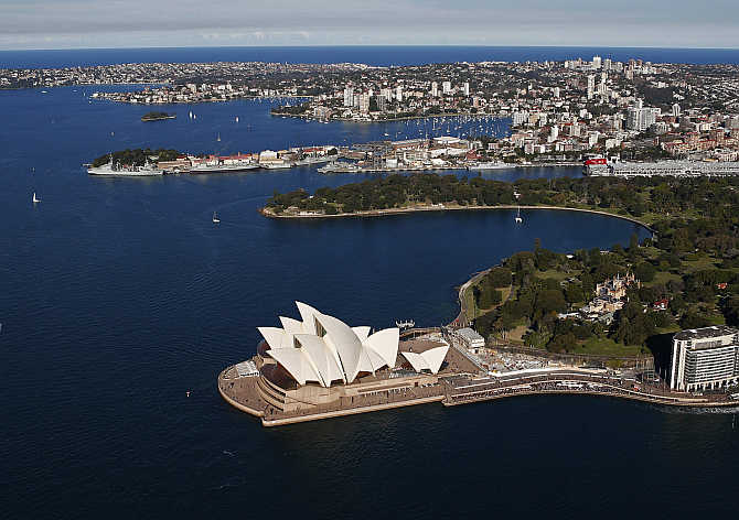 Sydney Opera House in front of eastern suburbs in Sydney, Australia.