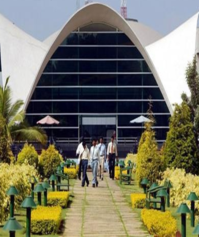 Staff walk in Infosys Technologies campus in Electronics City in Bangalore.