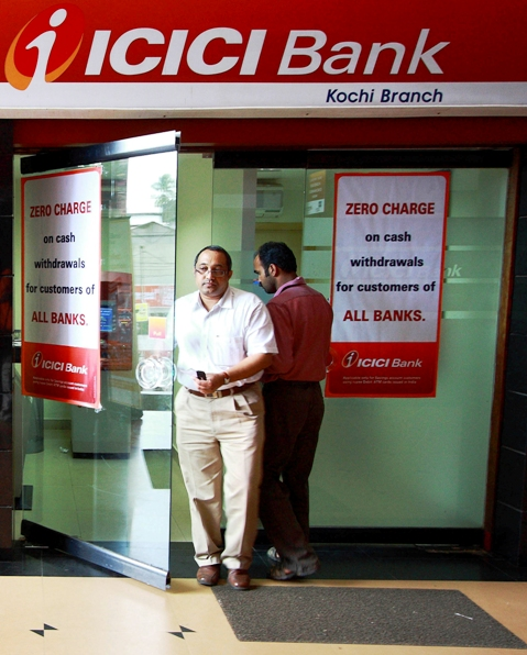 A man leaves an automated teller machine facility of ICICI bank in Kochi.