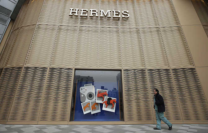 A man walks past a Hermes store in Wuhan, Hubei province, China.