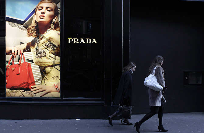People walk past a Prada store on Grafton Street in central Dublin, Ireland.