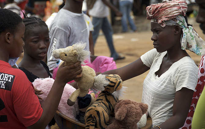 A woman sells toys at a market in the Liberian capital Monrovia.