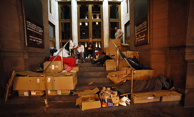 Homeless people eat food donated by a charity organisation in New York.