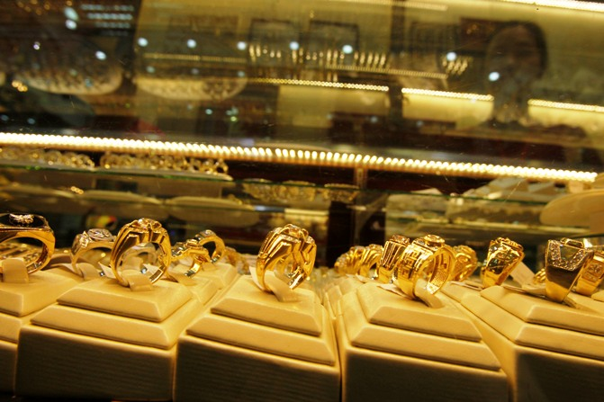 Gold products are displayed for sale at a shop.