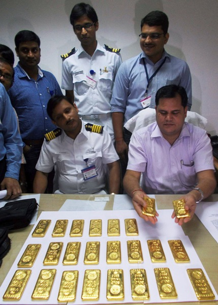 A customs officer displays seized gold bars at the international airport in Kolkata.