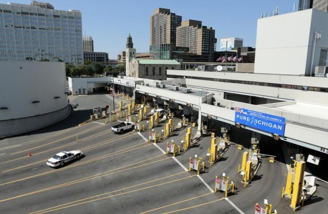 Police vehicles are pictured at empty customs lanes entering the US at the Detroit-Windsor Tunnel in Detroit. This is one of the busiest border crossings between the United States and Canada.