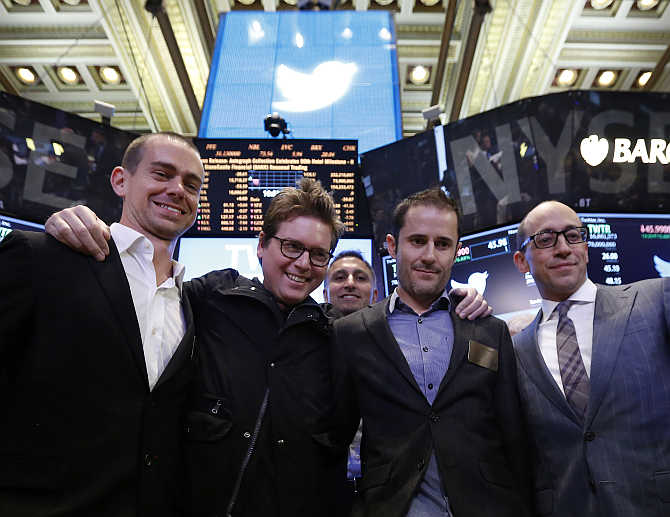 Twitter CEO Dick Costolo, right, celebrates the Twitter IPO with founders Jack Dorsey, left, Biz Stone, second left, and Evan Williams on the floor of the New York Stock Exchange.