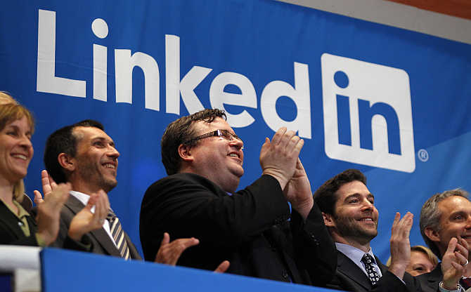 Founder of Linkedin Reid Garrett Hoffman, centre, applauds with CEO Jeffrey Weiner, secoond right, from the bell balcony at the New York Stock Exchange.