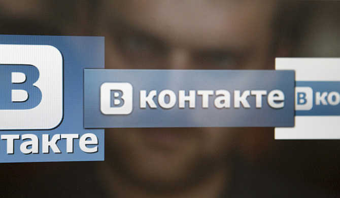 A man looks at a computer screen showing logos of Russian social network VKontakte in Moscow.