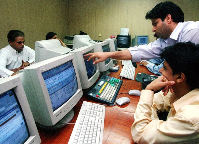 This file photo shows stock brokers at work in Mumbai.